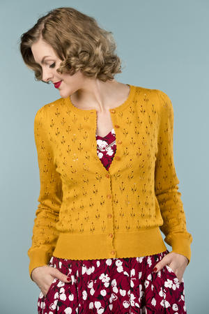 the cute as a button cardigan. mustard