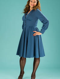the rock around the winter dress. teal dots