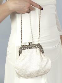 the past times purse. cream white